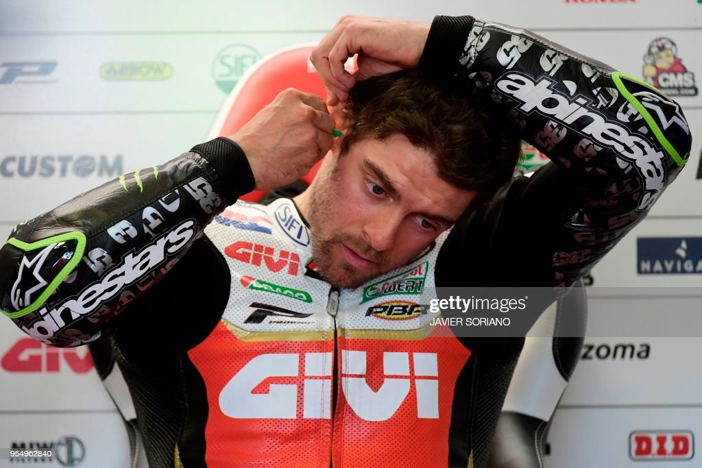 LCR Honda's British rider Cal Crutchlow puts an earplug in his ear before the MotoGP qualifying session of the Spanish Grand Prix at the Jerez racetrack in Jerez de la Frontera on May 05, 2018.