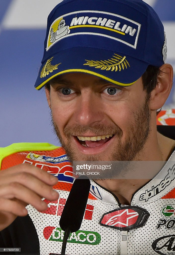 LCR Honda's British rider Cal Crutchlow reacts at the post race press conference following his win at the Australian MotoGP at Phillip Island on October 23, 2016. / AFP / PAUL