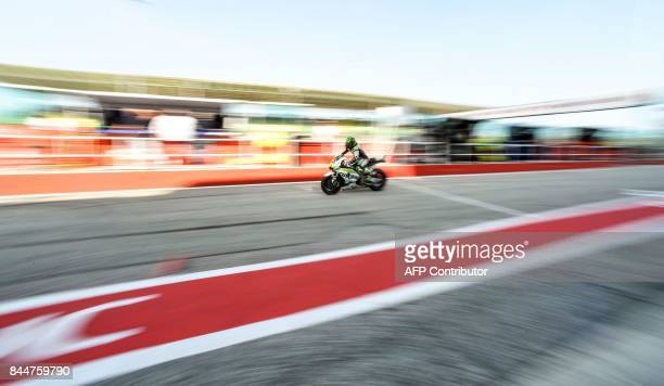 LCR Honda's British rider Cal Crutchlow rides his bike out of the pit during a free practice session of the San Marino Moto GP Grand Prix race at the...