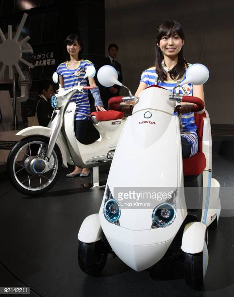 Honda's electric vehicles 'EVMonpal' are on display and 'EVCub' during the 41st Tokyo Motor Show at Makuhari Messe on October 21 2009 in Chiba Japan...