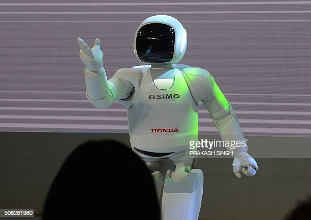 Honda's robot 'Ashimo' shows its skills by dancing to a Bollywood tune at Auto Expo 2016, in Greater Noida some 45kms east of New Delhi on February...