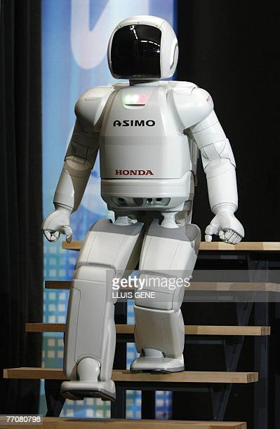 Honda's second version of the humanoid robot Asimo walks down a stairway, 28 September 2007, in Barcelona during its first appearance in Europe....