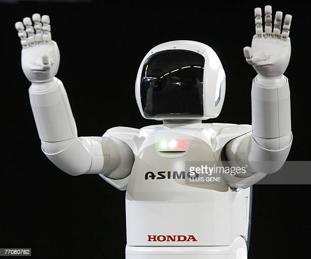 Honda's second version of the humanoid robot Asimo waves 28 September 2007 in Barcelona during its first appearance in Europe Standing at 130...