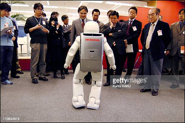 Honda'S Two Leg Robot, Asimo Was Hired By Ibm Innovation Center In Tokyo, Japan On March 06, 2002 - He guides customers to the meeting room and...