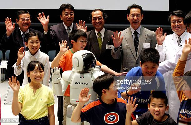 Honda's walking robot ASIMO poses for photographs during a press conference to explain The National Museum of Emerging Science and Innovation ASIMO...