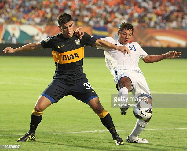 Hondouras' Leandro Paredes right fight for the ball with Mauricio Sabillion during the first half of a friendly between Argentina's Boca Juniors and...