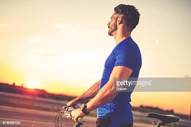 hondsome guy with bicycle in vintage image - drazen stock pictures, royalty-free photos & images