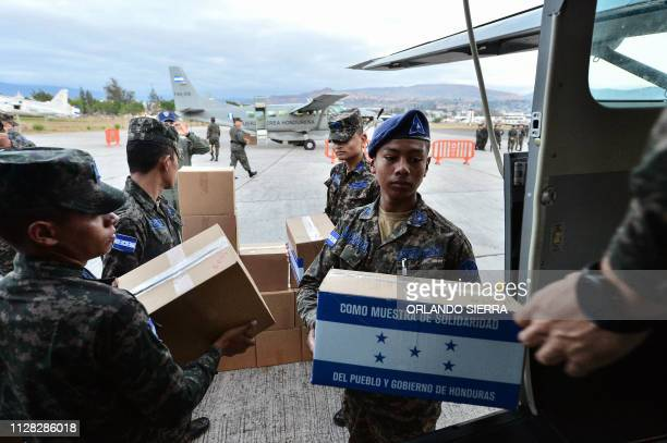 Honduran Air Force soldiers load humanitarian aid for Venezuela on an aircraft at Hernan Acosta Mejia air base in Tegucigalpa on March 01 2019 Three...