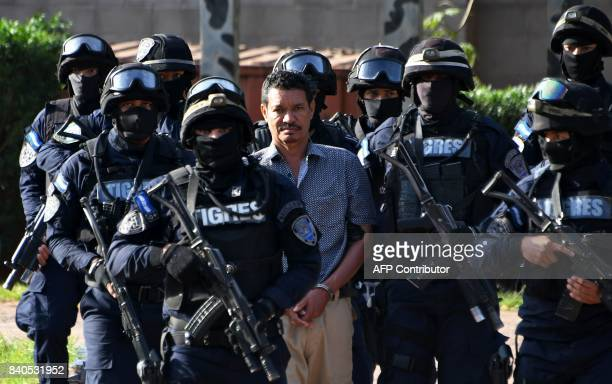 Honduran alleged drug trafficker Arnulfo Fagot Maximo aka El Tio wanted in the United States is escorted by members of the elite police unit Tigres...