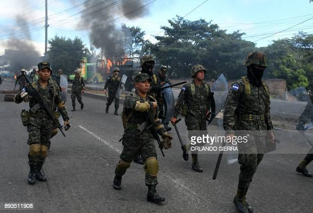 Honduran Army soldiers and members of the Special Riot Command COBRA clash with supporters of presidential candidate for the Opposition Alliance...