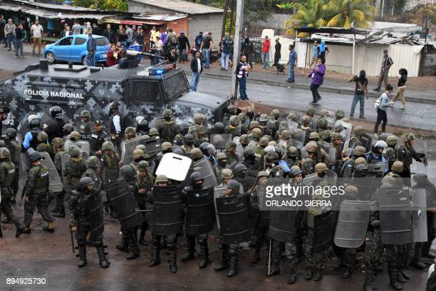Honduran Army soldiers get ready to disperse supporters of opposition candidate Salvador Nasralla who are blocking the vehicles' east accesses to...