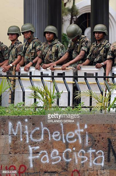 Honduran Army soldiers in riot gear stand guard at the Congress in Honduras July 15, 2009 in Tegucigalpa. Deposed President Manuel Zelaya has called...