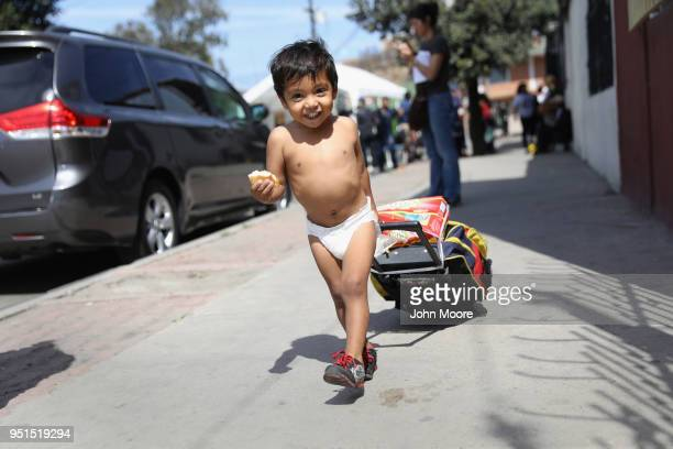 Honduran asylum seeker Daniel Once arrives to an immigrant shelter with his family on April 25 2018 in Tijuana Mexico More than 300 immigrants the...