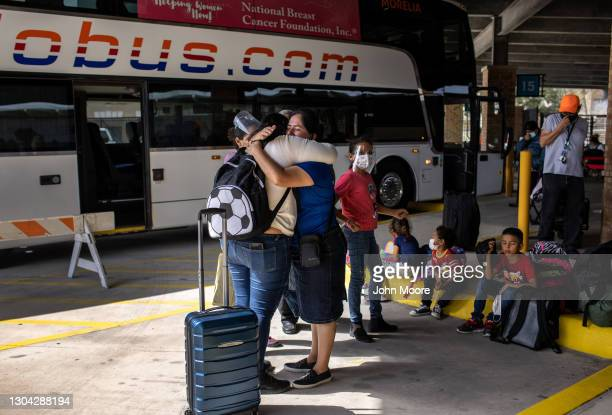 Honduran asylum seeker , embraces a church member upon arrival to the United States on February 26, 2021 in Brownsville, Texas. Her group of...