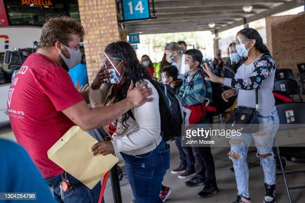 Honduran asylum seeker has an emotional reunion with migrant camp worker Brendan Tucker upon her arrival to the United States on February 26, 2021 in...
