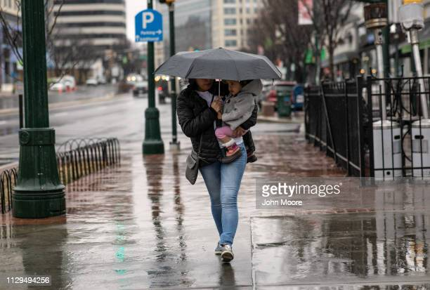Honduran asylum seeker Sandra Sanchez carries her daughter Yanela Sanchez 2 1/2 on February 11 2019 in the greater Washington DC area Photographs of...