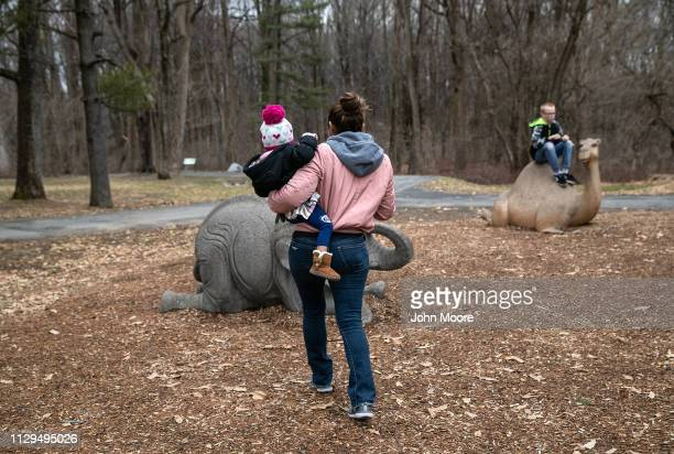 Honduran asylum seeker Sandra Sanchez carries her daughter Yanela Sanchez 2 1/2 at a playground on February 13 2019 in the greater Washington DC area...