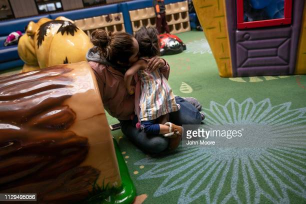 Honduran asylum seeker Sandra Sanchez embraces her daughter Yanela Sanchez 2 1/2 at a playground on February 13 2019 in the greater Washington DC...