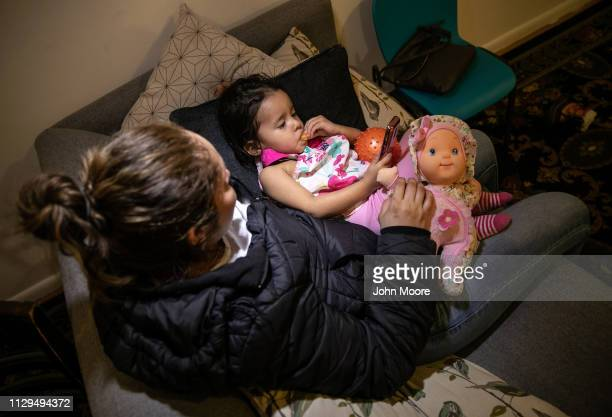 Honduran asylum seeker Sandra Sanchez holds her daughter Yanela Sanchez 2 1/2 in their basement apartment on February 11 2019 in the greater...
