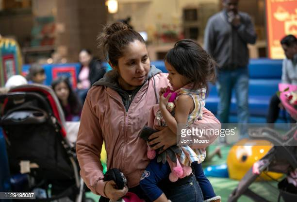 Honduran asylum seeker Sandra Sanchez holds her daughter Yanela Sanchez 2 1/2 at an indoor play area on February 13 2019 in the greater Washington DC...
