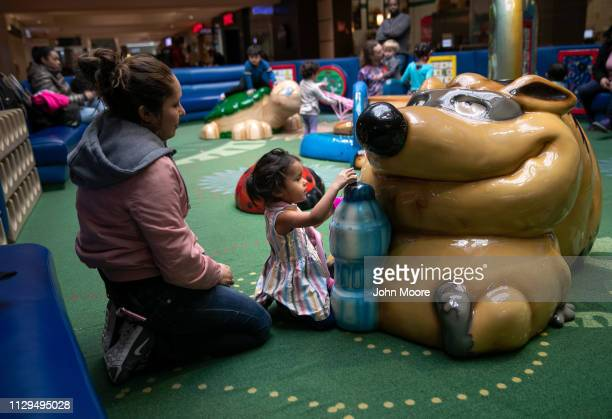Honduran asylum seeker Sandra Sanchez sits with her daughter Yanela Sanchez 2 1/2 at a playground on February 13 2019 in the greater Washington DC...