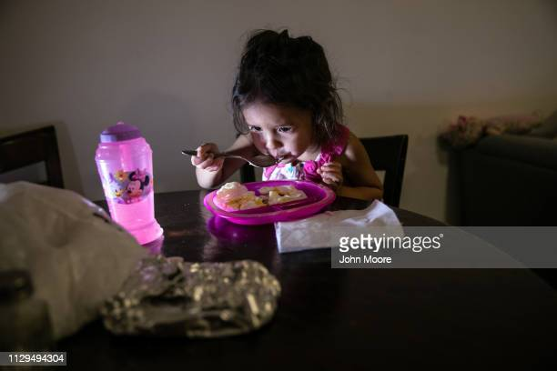 Honduran asylum seeker Yanela Sanchez 2 1/2 eats in the basement apartment she and her mother Sandra Sanchez share with other immigrants on February...