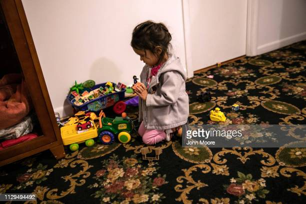 Honduran asylum seeker Yanela Sanchez 2 1/2 plays in the basement apartment she and her mother share with another immigrant family on February 11...