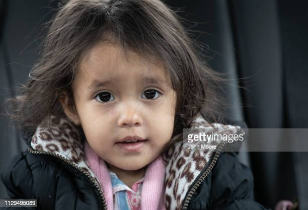 Honduran asylum seeker Yanela Sanchez 2 1/2 sits near her mother Sandra Sanchez on February 13 2019 in the greater Washington DC area Photographs of...