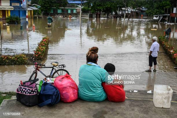 Honduran Blanca Rosa Calderon, who fled with her husband from the flooded La Guadalupe municipality with just two bikes and some clothes, remains...