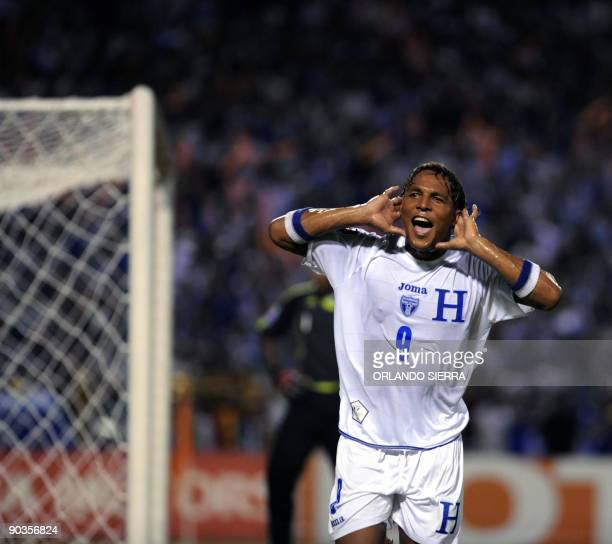 Honduran Carlos Pavon celebrates after scoring against Trinidad and Tobago during their FIFA World Cup South Africa2010 qualifier football match on...