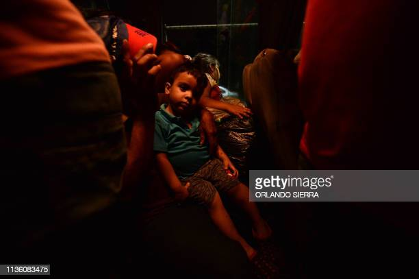 Honduran child and his mom are seen in a bus leaving the Metropolitan Center of San Pedro Sula 300 kms north of Tegucigalpa to travel to the...