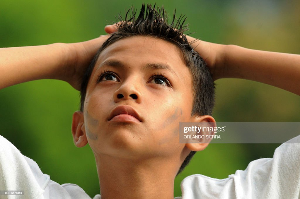 A Honduran child football fan watchs a FIFA World Cup Group H first round match against Chile on June 16, 2010, in San Pedro Sula, 240 km north of Tegucigalpa. Chile won 1-0. AFP PHOTO/Orlando Sierra