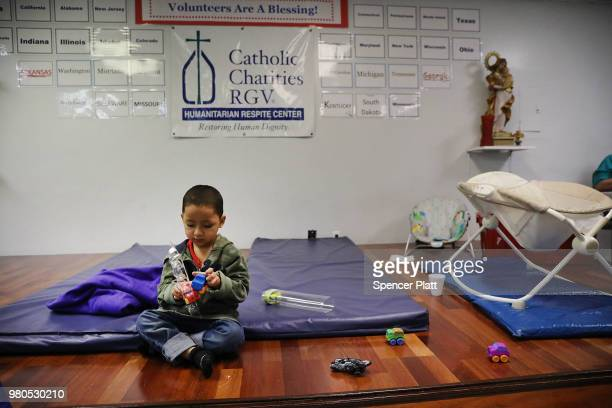 Honduran child plays at the Catholic Charities Humanitarian Respite Center after recently crossing the US Mexico border with his father on June 21...