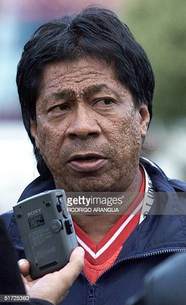 Honduran coach Ramon Madariaga makes a declaration 15 July 2001 during practice in Rio Negro Colombia Honduras lost against Costa Rica by 01 but will...