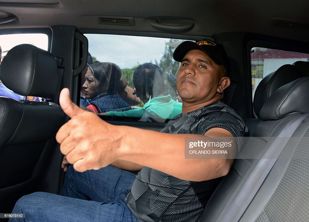 Honduran ex-Army captain Santos Orlando Rodriguez Orellana arrives at the Centre for Investigation and Promotion of Human Rights (CIPRODEH) in Tegucigalpa to ask for protection after he was discharged with dishonour from the Army on October 21, 2016. The Honduran Army discharged Rodriguez Orellana on Friday as the United States is investigating him for alleged corruption and ties to drugs gangs. Rodriguez Orellana said the allegations are false and announced he will appeal the decision. According to the military, his discharge was an order of President Juan Orlando Hernandez for having mentioned that his brother, deputy Antonio Hernandez, and Defence Minister Samuel Reyes, are singled out by the US Drug Enforcement Administration (DEA) for drug trafficking. / AFP / Orlando SIERRA