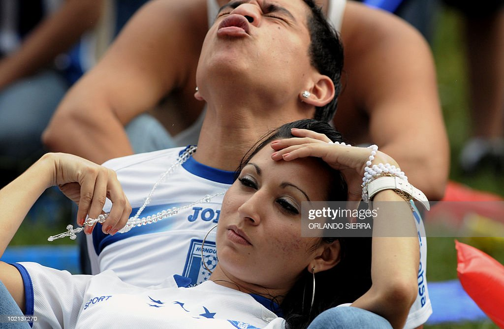 Honduran football fans react after their team lost 1-0 to Chile in their FIFA World Cup Group H first round match, on June 16, 2010, in San Pedro Sula, 240 km north of Tegucigalpa. AFP PHOTO/Orlando Sierra