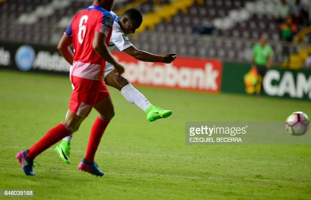Honduran footballer Darixon Vuelto shoots a goal next to Panama's Javier Rivera during their Under 20 Concacaf qualifying football match at the...