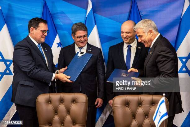 Honduran Foreign Minister Lisandro exchanges signed bilateral agreements with Israeli Foreign Minister Yair Lapid as Honduran President Juan Orlando...
