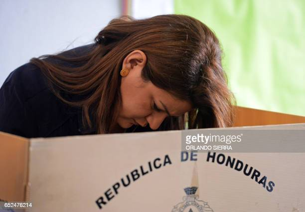 Honduran Foreign Minister Maria Dolores Aguero casts her vote during primary elections in Honduras, ahead of the November 26 general elections, on...