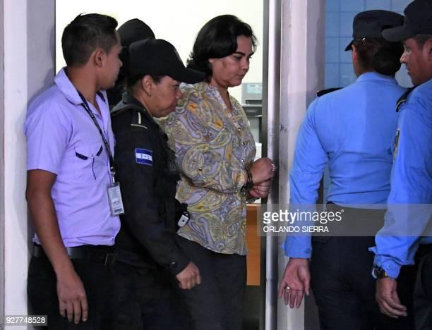 Honduran former first lady Rosa Elena Bonilla de Lobo wife of Honduran former president Porfirio Lobo Sosa is escorted after a judge issued a formal...