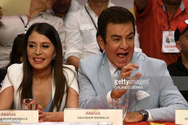Honduran former presidential candidate for the opposition Alliance against the Dictatorship Salvador Nasralla and his wife Iroshka Elvir attend a...