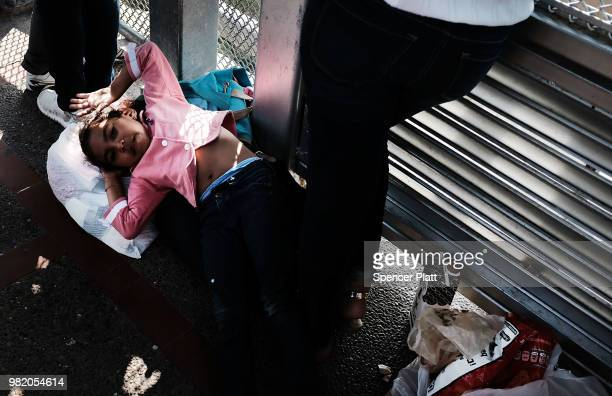 Honduran girl, fleeing poverty and violence in her home country, waits with her mother along the border bridge after being denied into the Texas city...