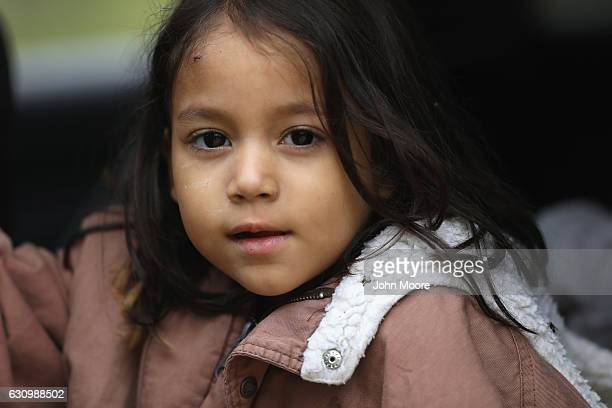 Honduran immigrant child awaits transport by US Border Patrol agents after crossing with her family into the United States on January 4 2017 near...