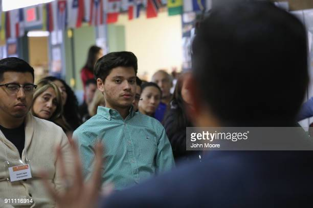 Honduran immigrant Michael Hernandez listens to an immigration attorney speak at a DACA and TPS workshop on January 27 2018 in Stamford Connecticut...