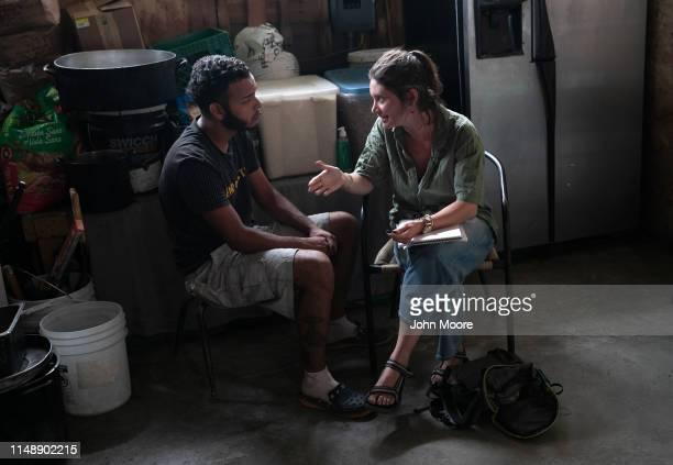 Honduran immigrant speaks with an American activist about requesting political asylum in the United States while at an immigrant shelter on May 09...