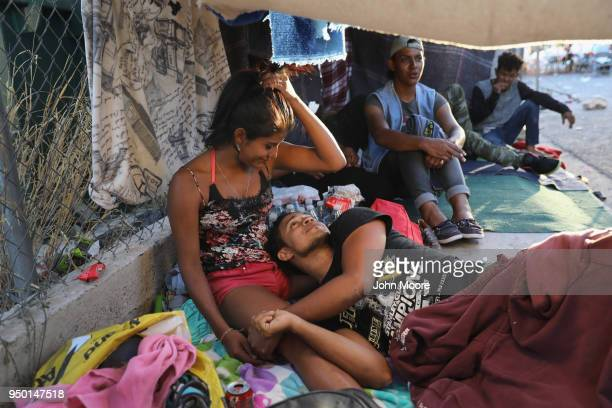 Honduran immigrants rest at a shelter while on their journey to the USMexico border on April 22 2018 in Hermosillo Mexico Some 600 immigrants part of...