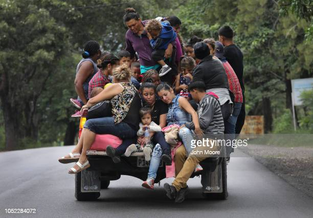 Honduran immigrants some of more than 1500 people in a migrant caravan travel north on October 16 2018 near Quezaltepeque Guatemala The caravan the...