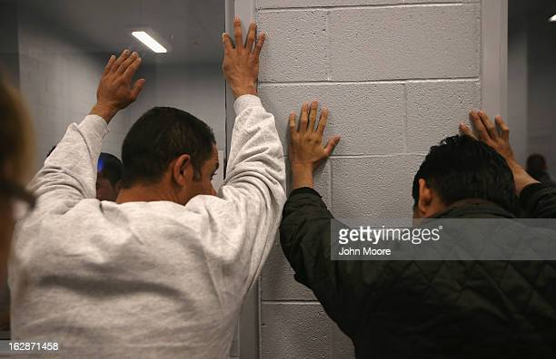 Honduran immigration detainees are searched before their US Immigration and Customs Enforcement deportation flight bound for San Pedro Sula Honduras...