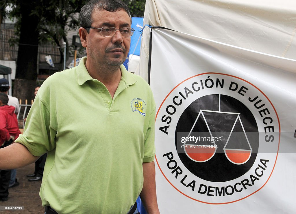 Honduran judge Adan Guillermo Lopez, (R) who with judge Luis Alonso Chevez are on hunger strike since seven days ago, walks at La Merced square in Tegucigalpa, May 24, 2010. Both judges were dismissed by the Supreme Court of Justice for having condemned the June 28, 2009's coup against President Manuel Zelaya. AFP PHOTO/Orlando SIERRA.