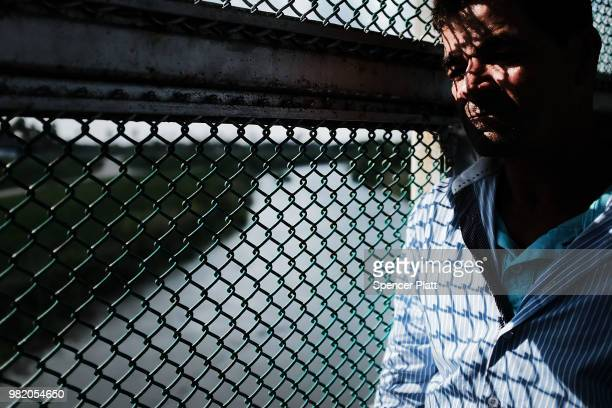A Honduran man fleeing poverty and violence in his home country waits along the border bridge after being denied into the Texas city of Brownsville...